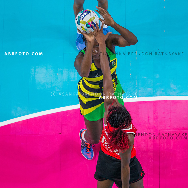 Jhaniele Fowler-Reid shoots as Ama Agbeze tries to block during Australia Vs Jamaica Fast5 Netball.
