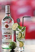 Bacardi Rum Cocktail with slices of lime in a highball glass