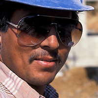 Construction worker Romero Munguea looks through his sunglasses bearing crossed American and Confederate flags at an Alexandria, VA constrction site. Release available.