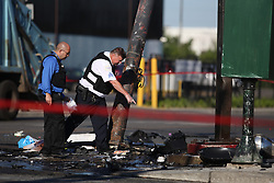 June 26, 2017 - Chicago, IL, USA - Chicago police officers collect evidence near the scene of a double fatal car crash that involved an off-duty police officer, at the intersection of South Kostner Avenue and West Roosevelt Road on Tuesday, June 27, 2017, in Chicago's Lawndale neighborhood. A woman and an off-duty Chicago police officer were killed. (Credit Image: © Alyssa Pointer/TNS via ZUMA Wire)