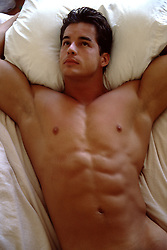 muscular man in bed