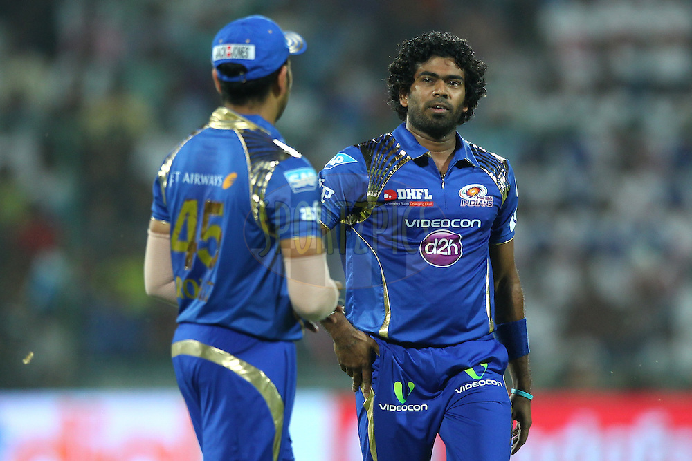 Lasith Malinga of the Mumbai Indians words with Rohit Sharma captain of the Mumbai Indians during match 21 of the Pepsi IPL 2015 (Indian Premier League) between The Delhi Daredevils and The Mumbai Indians held at the Ferozeshah Kotla stadium in Delhi, India on the 23rd April 2015.<br /> <br /> Photo by:  Deepak Malik / SPORTZPICS / IPL
