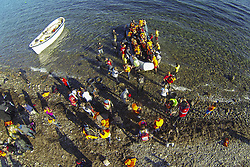 Nov. 13, 2015 - Eftalou, Greece - Drone images of migrants and refugees arriving in Lesvos island near the beach of Eftalou, between the villages Molivos and Skala Sikamias. Refugees travel on dinghies or wooden boats risking their lives, sometimes smugglers force them to do it. (Credit Image: © Nicolas Economou/NurPhoto via ZUMA Press)