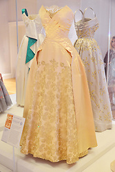 Fashion Rules, major new exhibition of Royal clothing.<br /> Dress from the collections of HM The Queen, Princess Margaret and Diana, Princess of Wales.  Major new exhibition focusing on 20th century Royal clothing. Sponsored by Estee Lauder Companies. Exhibition opens tomorrow.<br /> -Worn by HM The Queen.  Evening gown, probably Norman Hartnell, early 1950s, Kensington Palace, <br /> London, United Kingdom<br /> Wednesday, 3rd July 2013<br /> Picture by Nils Jorgensen / i-Images