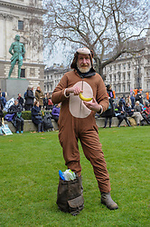 Extinction Rebellion campaigners came together in London for Rebellion Day 2. The protesters gathered on Parliament Square, some protesters dressed as animals whilst others carried images of endangered species. The pro-people and planet group are calling on the Government to reduce carbon emissions to net zero by 2025 and to reduce consumption levels. London, 24 November 2018.
