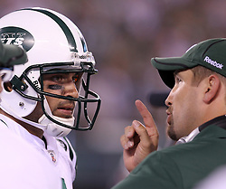 Sept 19, 2011; East Rutherford, NJ, USA; New York Jets quarterback Mark Sanchez (6) and offensive coordinator Brian Schottenheimer have a conversation during the 2nd half at the New Meadowlands Stadium.  The Jets defeated the Patriots 28-14.