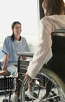 Physician Listening to Patient in wheelchair