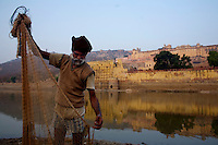 A man fishes with a net in a small lake just outside Jaipur City india Nov. 16, 2006 Jaipur India.    (photo by Darren Hauck)...............