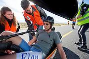 Ellen van Vugt na de ochtendrun op de derde dag van de races. In Battle Mountain (Nevada) wordt ieder jaar de World Human Powered Speed Challenge gehouden. Tijdens deze wedstrijd wordt geprobeerd zo hard mogelijk te fietsen op pure menskracht. Het huidige record staat sinds 2015 op naam van de Canadees Todd Reichert die 139,45 km/h reed. De deelnemers bestaan zowel uit teams van universiteiten als uit hobbyisten. Met de gestroomlijnde fietsen willen ze laten zien wat mogelijk is met menskracht. De speciale ligfietsen kunnen gezien worden als de Formule 1 van het fietsen. De kennis die wordt opgedaan wordt ook gebruikt om duurzaam vervoer verder te ontwikkelen.<br /> <br /> In Battle Mountain (Nevada) each year the World Human Powered Speed Challenge is held. During this race they try to ride on pure manpower as hard as possible. Since 2015 the Canadian Todd Reichert is record holder with a speed of 136,45 km/h. The participants consist of both teams from universities and from hobbyists. With the sleek bikes they want to show what is possible with human power. The special recumbent bicycles can be seen as the Formula 1 of the bicycle. The knowledge gained is also used to develop sustainable transport.