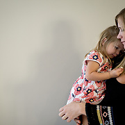 FORT MYERS, FLORIDA, JANUARY 29, 2017<br /> Erin Fahs, 33, holds her daughter, two year old Amelia in her house after a conference call with new inters in the company she works for called The Collective Good which does consulting for non profit organizations. Fahs works from her home and got her job using a new  Fahs is pregnant with her second child due in March.<br /> (Photo by Angel Valentin/Freelance)