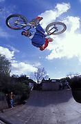 BMXer air off mini-ramp, U.K, 2000s.