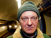 """An East European guest worker in Prague waiting to leave early morning with the subway from station """"Kolbenova"""" to his job on the other side of the city."""
