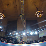 Kyle Dake, USA, (blue) in action against Hassan Tahmasebi, Iran, as wrestlers from USA, Iran and Russia compete at Grand Central Terminal as part of the Beat the Streets Gala. Billed ?The Rumble On The Rails,? the international wrestling event showcased competition as part of World Wrestling Month. Vanderbilt Hall, Grand Central Station, Manhattan,New York. USA. 15th May 2013. Photo Tim Clayton