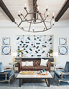 Multifamily lobby waiting area in leasing office. Blue themed interior design scheme.