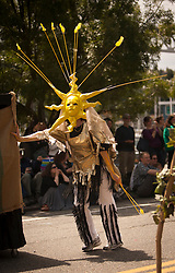 North America, United States, Washington, Seattle, person dressed as sun pushing float during annual Summer Solstice Parade in Fremont neighborhood