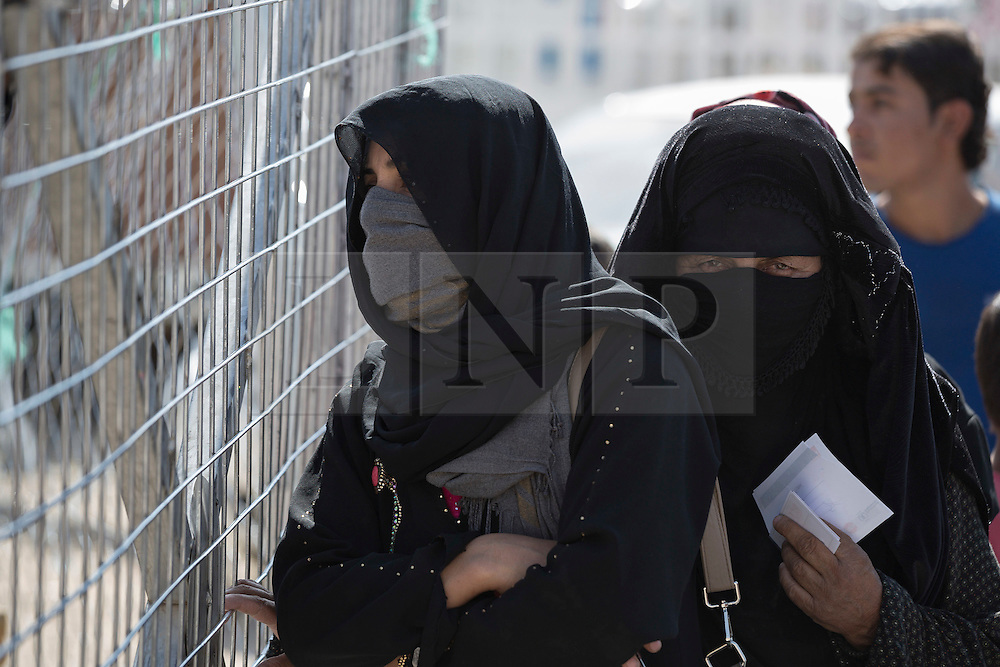 Licensed to London News Pictures. 20/10/2016. Iraqi women, recently arrived from areas liberated by the Iraqi Army from Islamic State militants, queue to receive food and hegiene kits from aid agencies in Dibaga Camp near Makhmur Iraq.<br /> <br /> The crowded Dibaga camp, housing around 28,000 Sunni Arab refugees, is the main gathering point for new IDPs now fleeing areas where ISIS have been pushed out or are in conflict with the Iraqi Army. Photo credit: Matt Cetti-Roberts/LNP