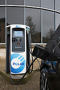 An Electric Vehicle charging at a chargemaster 'Polar Network' charging point. Chargemaster make and install charging points for electric vehicles through their Polar Network. © Andy Aitchison / Ashden
