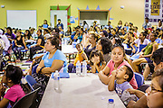 "18 AUGUST 2012 - PHOENIX, AZ:  People listen to immigration lawyers talk about the ""deferred action"" program during a deferred action workshop in Phoenix. More than 1000 people attended a series of 90 minute workshops in Phoenix Saturday on the ""deferred action"" announced by President Obama in June. Under the plan, young people brought to the US without papers, would under certain circumstances, not be subject to deportation. The plan mirrors some aspects the DREAM Act (acronym for Development, Relief, and Education for Alien Minors), that immigration advocates have sought for years. The workshops were sponsored by No DREAM Deferred Coalition.  PHOTO BY JACK KURTZ"
