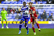 Reading forward Lucas Joao (31) tussles with Fulham defender Tim Ream (13) during the EFL Sky Bet Championship match between Reading and Fulham at the Madejski Stadium, Reading, England on 1 October 2019.