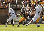September 21 2013: Iowa Hawkeyes running back Damon Bullock (5) tries to avoid Western Michigan Broncos cornerback Donald Celiscar (34) during the second quarter of the NCAA football game between the Western Michigan Broncos and the Iowa Hawkeyes at Kinnick Stadium in Iowa City, Iowa on September 21, 2013. Iowa defeated Western Michigan 59-3.