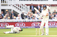 Joe Root (capt) of England is caught behind by Safraz Ahmed of Pakistan on Day One of the NatWest Test Match match at Lord's, London<br /> Picture by Simon Dael/Focus Images Ltd 07866 555979<br /> 24/05/2018