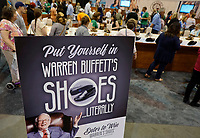 Berkshire Hathaway shareholders shop for shoes at the shareholder shopping day as part of the Berkshire Hathaway annual meeting weekend in Omaha, Nebraska May 5 2017. REUTERS/Rick Wilking