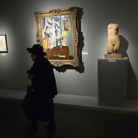 """BRESCIA, ITALY - FEBRUARY 11:  A visitor walks in front of """"Greek Torso with Flowers"""" by Matisse at the  Santa Giulia Museum on February 11, 2011 in Brescia, Italy. The exhibition """"Matisse La Seduzione di Michelangelo"""" shows  180 works of the French artist and will stay open until June 12th 2011"""