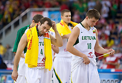 Andrius Mazutis of Lithuania and Arturas Jomantas of Lithuania of Team of Lithuania finished with the last game at the EuroBasket 2009 Group F match between Serbia and Lithuania, on September 16, 2009 in Arena Lodz, Hala Sportowa, Lodz, Poland.  (Photo by Vid Ponikvar / Sportida)