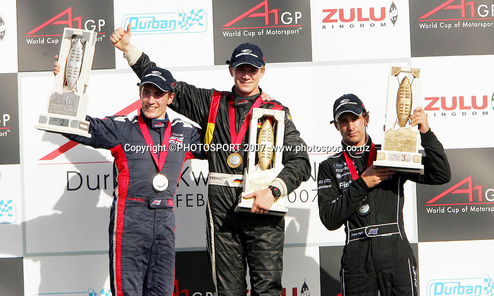 Robbie Kerr of Team Great Britain, Nico Hulkenberg of Team Germany and Matt Halliday of Team New Zealand celebrate after the feature race held as part of the A1GP race weekend in Durban, South Africa on Sunday 25th February 2007. Team Germany won the race, Team Great Britain were second and Team New Zealand were third.  Photo: Ron Gaunt/PHOTOSPORT<br /> <br /> <br /> <br /> <br /> <br /> <br /> <br /> 250207