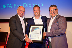 NEWPORT, WALES - Friday, May 18, 2018: Michael Flynn receives his UEFA Pro Licence Diploma from Lennie Lawrence (left) and Wales technical director Osian Roberts (right) during day one of the Football Association of Wales' National Coaches Conference 2018 at the Celtic Manor Resort. (Pic by David Rawcliffe/Propaganda)