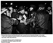 Norman Rosenbaum pushing through cops to march across Brooklyn Bridge to City Hall. ( After Jury acquited Lemrick Nelson of murdering  Norman Rosenbaum's younger brother.) New York. 1992. Film 92935/36<br />