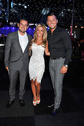 Left to right, ?, SOPHIE KANE and MARK WRIGHT at the F1 Party in aid of Great Ormond Street Hospital Children's Charity held at Battersea Evolution, Battersea Park, London on 4th July 2012.