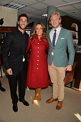 Left to right, racing driver DANIEL RICCIARDO, NATALIE PINKHAM and OWAIN WALBYOFF at the 2013 Hennessy Gold Cup at Newbury Racecourse, Berkshire on 30th November 2013.