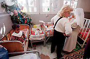 1/5/01 -- (PHOTO BY MIKE FENDER) w/ story, slug: AFRICA, file: 62040 // Cheryl Carter-Shotts checks out cribs full of babies at St. Mary's orphanage in Addis Ababa, Ethiopia during a visit in January. She came looking for children in need of adoption but found all the babies there had adoptions in the works that would send them to Europe.