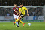 Burton Albion midfielder Ben Fox (12) and Aston Villa defender Ritchie De Laet (2) during the second round or the Carabao EFL Cup match between Burton Albion and Aston Villa at the Pirelli Stadium, Burton upon Trent, England on 28 August 2018.