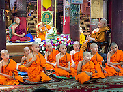 "06 APRIL 2015 - CHIANG MAI, CHIANG MAI, THAILAND: Newly ordained Buddhist novices after their first chanting service as monks during their ordination ceremony on the last day of the three day long Poi Song Long Festival in Chiang Mai. The Poi Sang Long Festival (also called Poy Sang Long) is an ordination ceremony for Tai (also and commonly called Shan, though they prefer Tai) boys in the Shan State of Myanmar (Burma) and in Shan communities in western Thailand. Most Tai boys go into the monastery as novice monks at some point between the ages of seven and fourteen. This year seven boys were ordained at the Poi Sang Long ceremony at Wat Pa Pao in Chiang Mai. Poy Song Long is Tai (Shan) for ""Festival of the Jewel (or Crystal) Sons.   PHOTO BY JACK KURTZ"