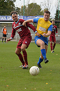 Croydon Athletic midfielder Jack Higgins (left) battles with Hollands and Blair player during the Southern Counties East match between AFC Croydon Athletic and Hollands & Blair at the Mayfield Stadium, Croydon, United Kingdom on 10 October 2015. Photo by Mark Davies.