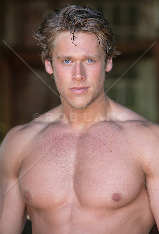portrait of a handsome All American man with blue eyes and blond hair
