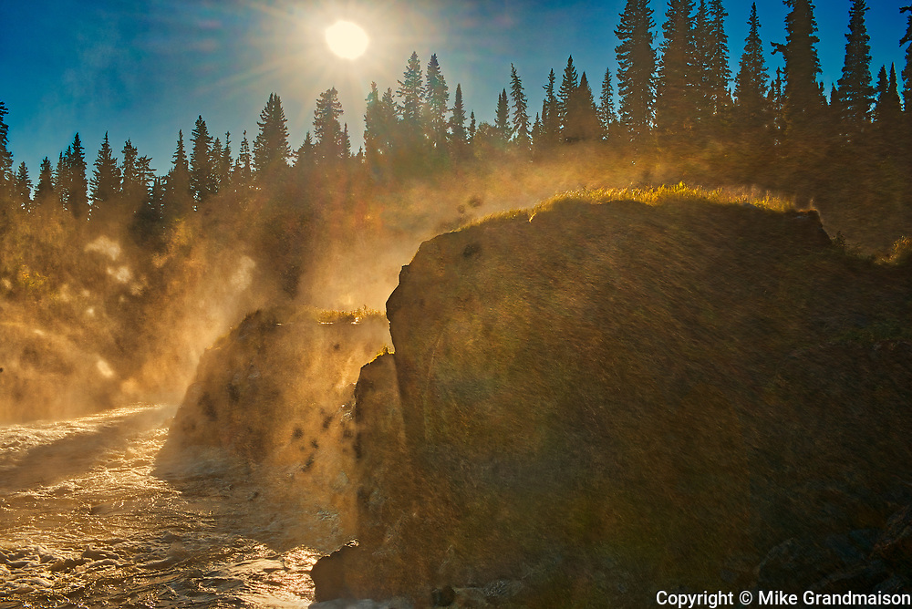 SUn streaking through the morning mist on the Grass River at Pisew Falls<br />Pisew Falls Provincial Park<br />Manitoba<br />Canada