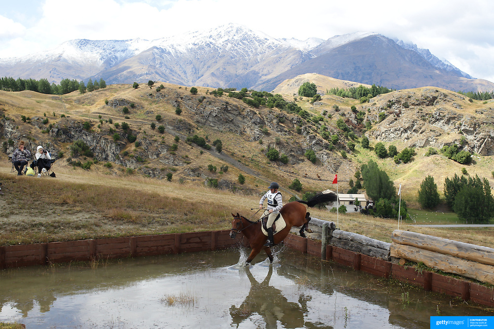 Brad Avery riding Felix in action at the water jump during the Cross Country event at the Wakatipu One Day Horse Trials at the Pony Club grounds,  Queenstown, Otago, New Zealand. 15th January 2012. Photo Tim Clayton
