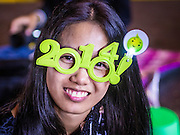 31 DECEMBER 2013 - BANGKOK, THAILAND:  A woman at the New Year's Eve party in Ratcharprasong Intersection in Bangkok. Hundreds of thousands of people pack into the Ratchaprasong Intersection in Bangkok for the city's annual New Year's Eve countdown. Many Thais go the Erawan Shrine and Wat Pathum Wanaram near the intersection to pray and make merit.    PHOTO BY JACK KURTZ