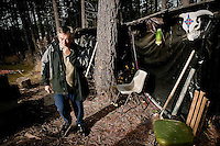 """JEROME A. POLLOS/Press..Glen Lambert walks along the outside of a sweat house located in the backyard of his Plummer home after giving a tour of the lodge Thursday and discussing how he oversees """"sweats"""" for both tribal and non-tribal members."""
