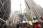 Workers prepare to raise the Swarovski Star to the top of the 75-foot Rockefeller Center Christmas tree, Thursday, Nov. 16, 2017, in New York. The 85th Rockefeller Center Christmas Tree Lighting ceremony will take place on Wednesday, November 29. (Diane Bondareff/AP Images for Tishman Speyer)