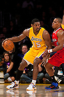 25 February 2011: Forward Ron Artest of the Los Angeles Lakers backs in Randy Foye of the Los Angeles Clippers towards the basket during the first half of the Lakers 108-95 victory over the Clippers at the STAPLES Center in Los Angeles, CA.