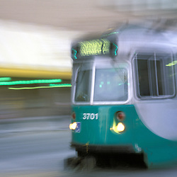 MBTA Green Line subway car in motion at dusk, Boston, MA.