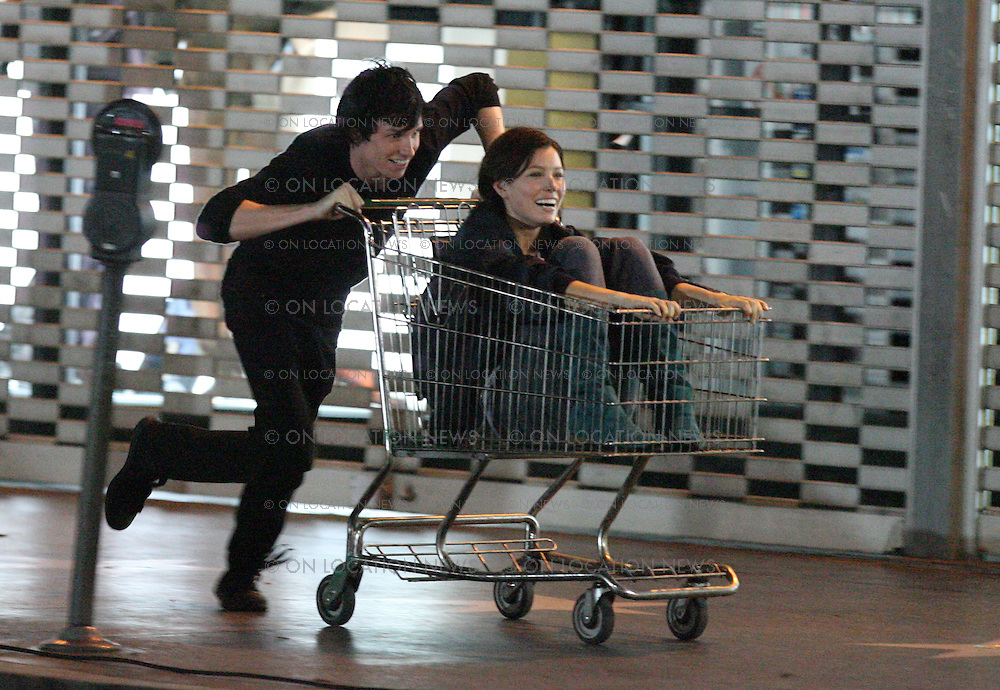 HOLLYWOOD, CALIFORNIA - Wednesday 5th September 2007. EXCLUSIVE: Actress Jessica Biel shooting scenes for her latest movie 'Powder Blue'. In this scene Biel is pushed down Hollywood Blvd. in a shopping cart by her co-star Edward Redmayne. Photograph: David Buchan/Eric Ford On Location News. Sales: Eric Ford 1/818-613-3955 info@onlocationnews.com