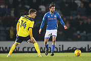 Joe Rafferty passes the ball during the EFL Sky Bet League 1 match between Rochdale and Oxford United at Spotland, Rochdale, England on 16 December 2017. Photo by Daniel Youngs.