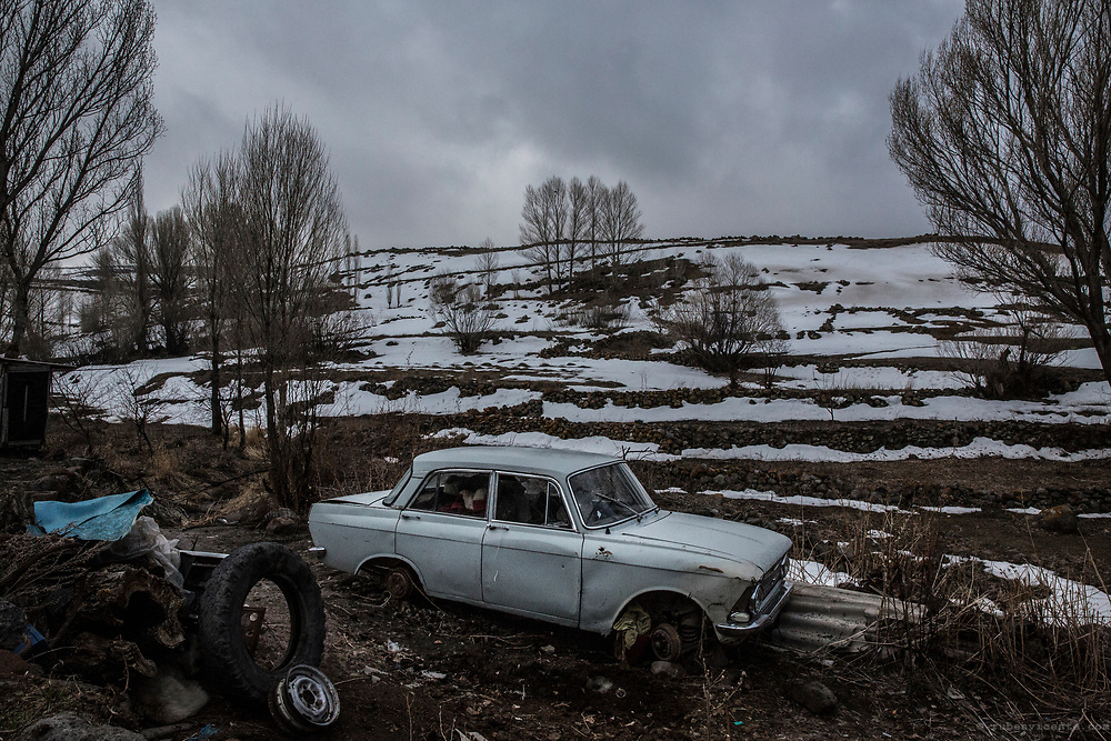 Abandoned car on a snowy landscape at Garnahovit. Armenia