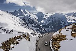 THEMENBILD - ein Auto beim Fuschertoerl Blick Richtung Grossglockner. Die Grossglockner Hochalpenstrasse verbindet die beiden Bundeslaender Salzburg und Kaernten und ist als Erlebnisstrasse vorrangig von touristischer Bedeutung, aufgenommen am 23. Mai 2019 in Fusch a. d. Grossglocknerstrasse, Österreich // a car at Fuschertoerl view towards Grossglockner. The Grossglockner High Alpine Road connects the two provinces of Salzburg and Carinthia and is as an adventure road priority of tourist interest, Fusch a. d. Grossglocknerstrasse, Austria on 2019/05/23. EXPA Pictures © 2019, PhotoCredit: EXPA/ JFK