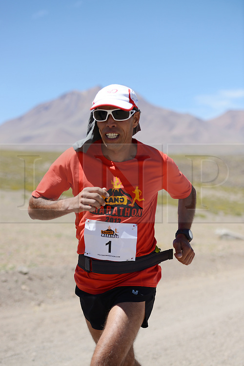 © Licensed to London News Pictures. 14/11/2013.<br /> <br /> Eventual race winner Mohamad Ahansal, Morocco 3.55.15 Bib No. 1 in action.<br /> <br /> Inaugural Volcano Marathon, Atacama Desert, Chile. The race took place in the Atacama Desert in Chile, beginning at an altitude of 4,400 metres (14,500 feet) in the vicinity of Lascar Volcano. It was a gruelling affair for many of the competitors who had to encounter some challenging hills and manage the impact of the heat and oxygen deprivation. The average altitude of the entire race was close to 4,000 metres and temperatures reached the mid 20s Celsius, or almost 80 Degrees Farenheit.<br /> <br /> Photo credit : Mike King/LNP<br /> <br /> Further information and link to video here: https://www.dropbox.com/s/0277bepxvo0t8il/Marathon%20copy.txt
